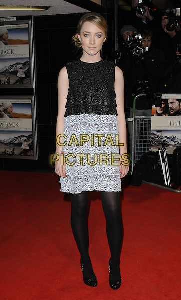 """SAOIRSE RONAN .""""The Way Back"""" UK Film Premiere, .Curzon Mayfair cinema, Curzon Street, London, England, UK, .8th December 2010..full length black lace white tiered dress sleeveless tights shoes .CAP/CAN.©Can Nguyen/Capital Pictures."""