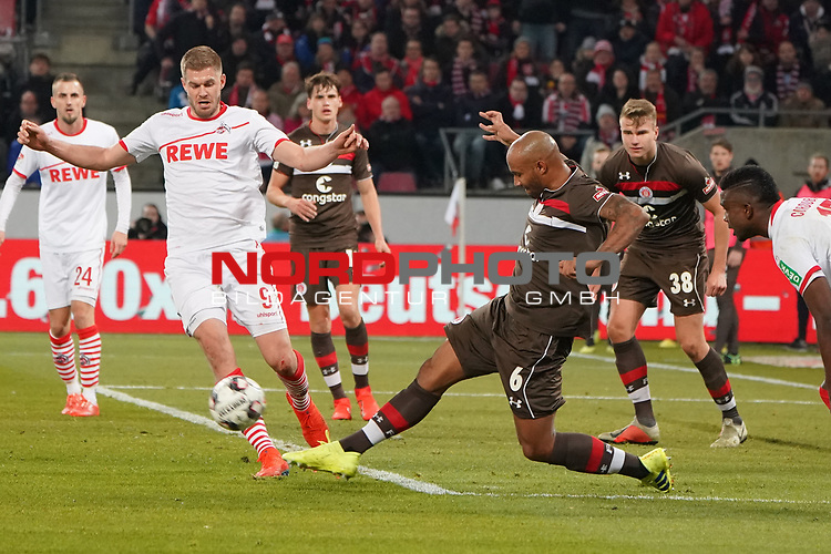 08.02.2019, RheinEnergieStadion, Koeln, GER, 2. FBL, 1.FC Koeln vs. FC St. Pauli,<br />  <br /> DFL regulations prohibit any use of photographs as image sequences and/or quasi-video<br /> <br /> im Bild / picture shows: <br /> Simon Terodde (FC Koeln #9), im Zweikampf gegen  Christopher Avevor (St Pauli #6), <br /> <br /> Foto &copy; nordphoto / Meuter