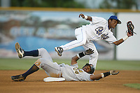 Erick Aybar of the Rancho Cucamonga Quakes catches a throw to second base during a 2004 season California League game at The Epicenter in Rancho Cucamonga, California. (Larry Goren/Four Seam Images)