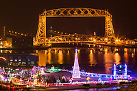 The annual holiday lights display in Duluth's Bayfront Festival Park adds cheer in the foreground of the Aerial Lift Bridge. Millions of lights and holiday music accompany the joy of visitors.