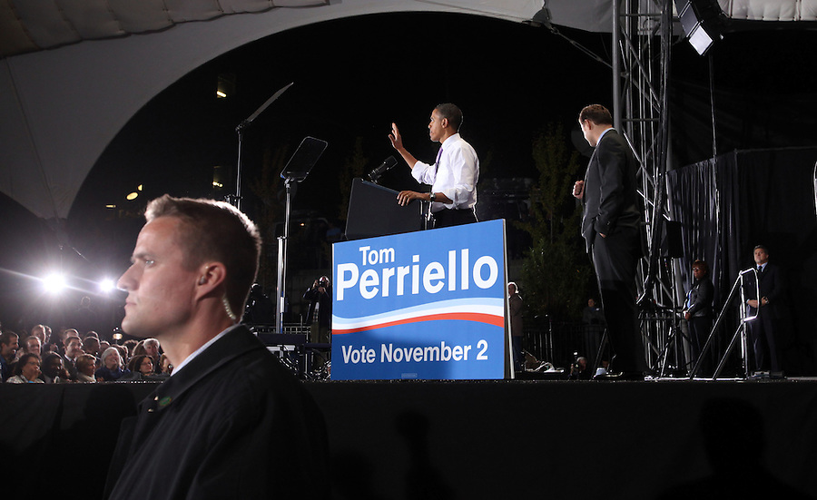 Oct 29, 2010. President Barack Obama, left, and Virginia 5th District Representative Congressman Tom Perriello, right, address a large crowd Friday during a campaign rally at the Charlottesville Pavilion in downtown Charlottesville, Va. Photo/Andrew Shurtleff