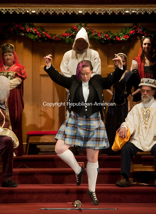 WINSTED, CT--- -011016JS09--Karen LaValle Tente performs the traditional Scottish Sword Dance during the final performance of the 26th annual Boar's Head Festival held Sunday at the First Church of Winsted. <br /> Jim Shannon Republican-American