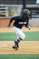 Kevin Jordan (21) of the Wake Forest Demon Deacons hustles down the first base line against the Towson Tigers at Wake Forest Baseball Park on March 1, 2015 in Winston-Salem, North Carolina.  The Demon Deacons defeated the Tigers 15-8.  (Brian Westerholt/Four Seam Images)