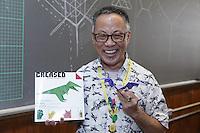 Talo Kawasaki, New York, origami designer and folder, holds a bat model he has created.