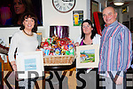 Mary O'Neill, Bernie Griffin and Ken O'Neill with some of the prizes at the Pyjama party in the Plough bar Milltown on Saturday night