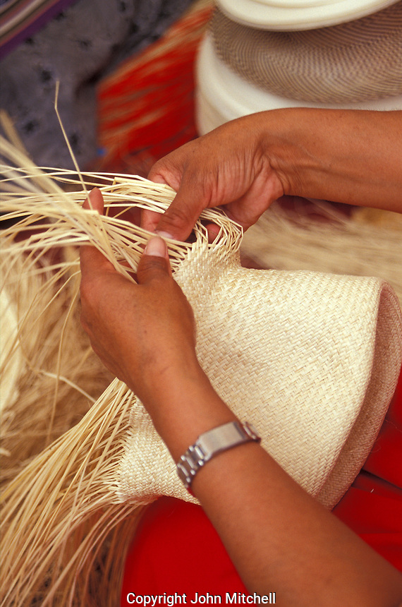 Close-p of woman's hands weaving A Panama hats or sombrero de paja toquilla in Ecuador, South America