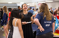NWA Democrat-Gazette/JASON IVESTER<br /> Sage Hartman (from left), freshman, Kacey Sakamoto, sophomore, and Kayle (cq) Thompson, freshman, chat and sample foods Thursday, April 20, 2017, during an international festival at Bentonville West High School in Centerton. Students in foreign language classes at the school researched approximately 30 countries for the display.