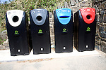 Four recycling bins for sorted refuse collection