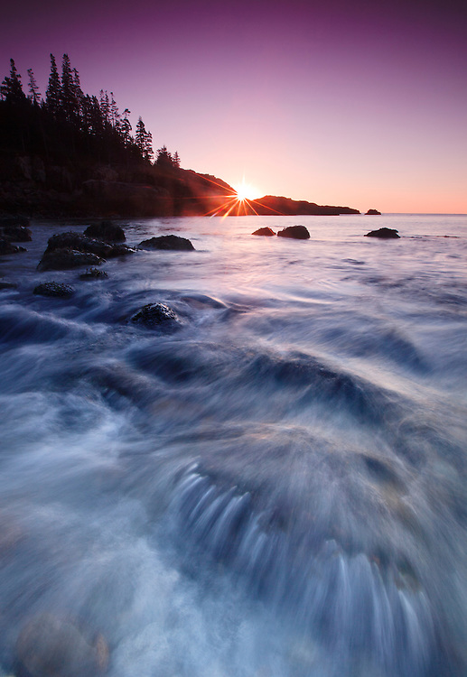Waves tumble over the volcanic rocks at Little Hunter's Beach at sunrise in Acadia National Park, Mount Desert Island; Maine, USA