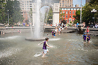 Day campers enjoy the fountain in Washington Square Park in Greenwich Village in New York on Monday, July 25, 2016. Temperatures are expected to be in the 90's F with excessive humidity breaking for thunderstorms in the late afternoon. The city has issued a heat advisory with cooling centers throughout the five boroughs. ( © Richard B. Levine)