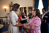 First Lady Michelle Obama greets guests in the Blue Room of the White House during a Mother's Day Tea for military spouses, relatives, and friends, May 6, 2011.  .Mandatory Credit: Lawrence Jackson - White House via CNP