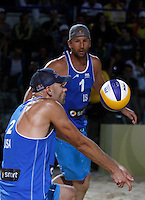 Phil Dalhausser, left, and Sean Rosenthal, of the United States, in action during the men's final match between Usa and Latvia at the Beach Volleyball World Tour Grand Slam, Foro Italico, Rome, 23 June 2013. USA defeated Latvia 2-0.<br /> UPDATE IMAGES PRESS/Isabella Bonotto