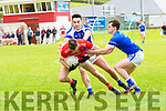 Daingean Uí Chúis Cathal Ó Bambaire in possession of the ball tackled by Kerins O'Rahilly's Tom Hoare and David Murphy during the Senior County Football League Div 1 Round 4 match at Pairc an Aghasaigh, Dingle, on Sunday afternoon.