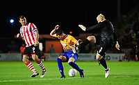 Mansfield Town's Conrad Logan hits his clearance against team-mate Matt Preston, under pressure from Lincoln City's Matt Rhead<br /> <br /> Photographer Chris Vaughan/CameraSport<br /> <br /> The EFL Checkatrade Trophy Group H - Lincoln City v Mansfield Town - Tuesday September 4th 2018 - Sincil Bank - Lincoln<br />  <br /> World Copyright © 2018 CameraSport. All rights reserved. 43 Linden Ave. Countesthorpe. Leicester. England. LE8 5PG - Tel: +44 (0) 116 277 4147 - admin@camerasport.com - www.camerasport.com