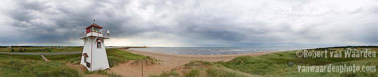 Panorama of lighthouse and beach, Cavendish National Park, Prince Edward Island, Canada.