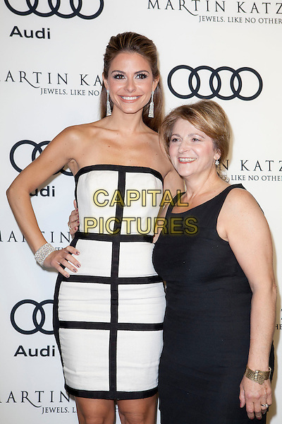Maria Menounos & guest.Audi And Martin Katz Kick Off Golden Globes Week 2012 Held At Cecconi's Restaurant, West Hollywood, California, USA..January 8th, 2012.half length white black strapless hand on hip dress sleeveless.CAP/ADM/ES.©Emiley Schweich/AdMedia/Capital Pictures.