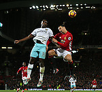 Michail Antonio of West Ham United challenged by Zlatan Ibrahimovic of Manchester United during the Premier League match at the Old Trafford Stadium, Manchester. Picture date: November 27th, 2016. Pic Simon Bellis/Sportimage