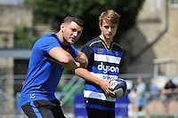 Jeff Williams of Bath Rugby runs the passing clinic. Bath Rugby Family Festival of Rugby, on August 8, 2015 at the Recreation Ground in Bath, England. Photo by: Patrick Khachfe / Onside Images