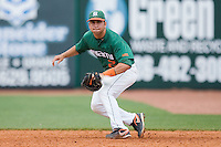First baseman Scott Lawson #2 of the Miami Hurricanes keeps his eye on a ground ball against the Virginia Cavaliers at the 2010 ACC Baseball Tournament at NewBridge Bank Park May 29, 2010, in Greensboro, North Carolina.  The Cavaliers defeated the Hurricanes 12-8.  Photo by Brian Westerholt / Four Seam Images