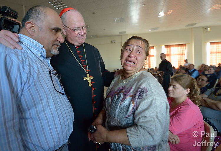 Cardinal Timothy Dolan, the archbishop of New York, listens to Amal Mare during a visit to a camp for internally displaced families in Ankawa, near Erbil, Iraq, on April 9, 2016. Dolan, chair of the Catholic Near East Welfare Association, is in Iraqi Kurdistan with other church leaders to visit with Christians and others displaced by ISIS. Mare began weeping while asking Dolan how long it would be until she and her family could return to their home in Qaraqosh. She said they had been praying the rosary every night, but were tired of living in misery and wanted to go home.<br /> <br /> On the left is Michel Constantin, the CNEWA emergency response coordinator for the region.