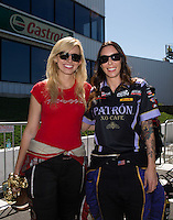 Jun. 1, 2014; Englishtown, NJ, USA; NHRA funny car driver Courtney Force (left) poses for a photo with Alexis DeJoria during the Summernationals at Raceway Park. Mandatory Credit: Mark J. Rebilas-