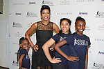 Tamron Hall and Harlem Figure Skaters - The 11th Annual Skating with the Stars Gala - a benefit gala for Figure Skating in Harlem on April 11, 2016 on Park Avenue in New York City, New York with many Olympic Skaters and Celebrities. (Photo by Sue Coflin/Max Photos)