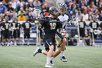 Annapolis, MD - April 15, 2017: Army Black Knights David Symmes (16) keeps the Navy Midshipmen defender off his stick during game between Army vs Navy at  Navy-Marine Corps Memorial Stadium in Annapolis, MD.   (Photo by Elliott Brown/Media Images International)