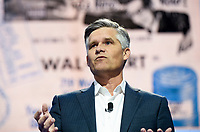 NWA Democrat-Gazette/CHARLIE KAIJO Executive Vice President and Chief Financial Officer, Walmart Brett Biggs speaks during the Walmart shareholders meeting, Friday, June 7, 2019 at the Bud Walton Arena in Fayetteville.