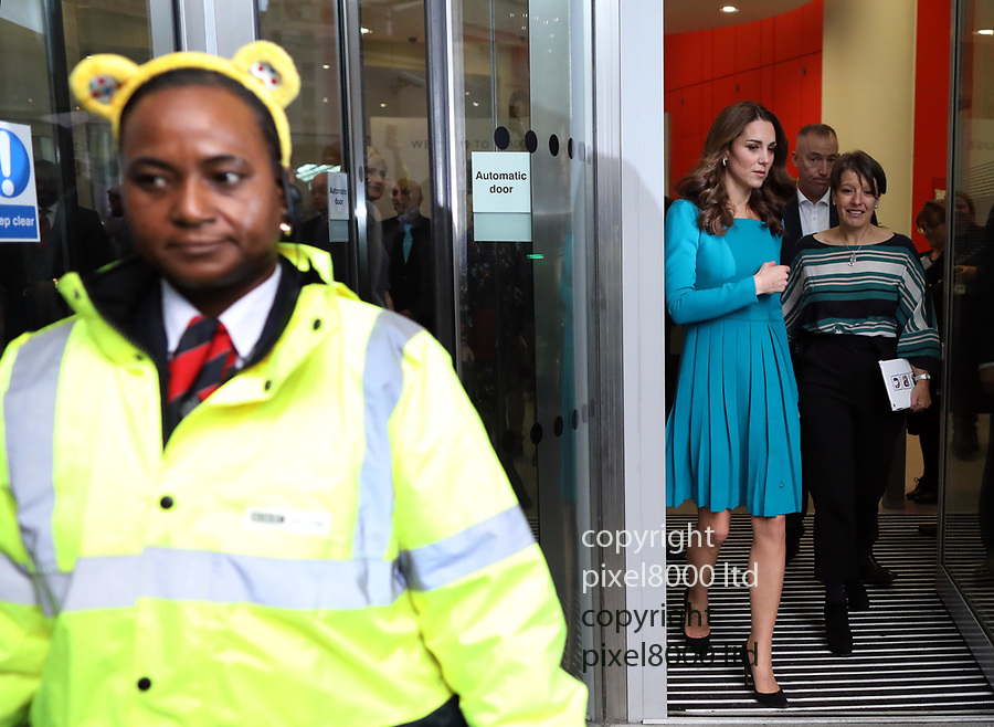 Pic shows: Kate  Duchess of Cambridge at the BBC today<br /> Security guard with Pudsey ears<br /> 15.11.12<br /> <br /> <br /> <br /> <br /> pic by Gavin Rodgers/Pixel8000
