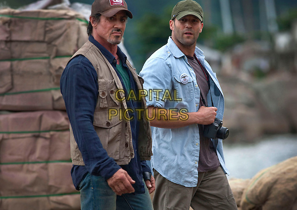 SYLVESTER STALLONE & JASON STATHAM.in The Expendables.*Filmstill - Editorial Use Only*.CAP/FB.Supplied by Capital Pictures.