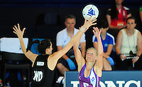 New Zealand's Anna Harrison tries to block a pass from Scotland's Claire Brownie<br /> <br /> Scotland Vs New Zealand - preliminary round - group A<br /> <br /> Photographer Chris Vaughan/CameraSport<br /> <br /> 20th Commonwealth Games - Day 3 - Saturday 26th July 2014 - Netball - SECC - Glasgow - UK<br /> <br /> © CameraSport - 43 Linden Ave. Countesthorpe. Leicester. England. LE8 5PG - Tel: +44 (0) 116 277 4147 - admin@camerasport.com - www.camerasport.com