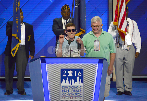 Timmy Kelly, 23, of Philadelphia, Pennsylvania who was born blind and with cerebral palsy, rehearses the National Anthem which he will sing to open the second day of the 2016 Democratic National Convention held at the Wells Fargo Center in Philadelphia, Pennsylvania on Tuesday, July 26, 2016. Timmy, a senior music major at Temple University is known as the Eagles' &quot;good luck charm&quot; because of their win record when he sings before their games.<br /> Credit: Ron Sachs / CNP/MediaPunch<br /> (RESTRICTION: NO New York or New Jersey Newspapers or newspapers within a 75 mile radius of New York City)