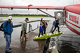 USA, Alaska, Anchorage, loading Rusts Flying Service float plane from Anchorage to Redoubt Bay