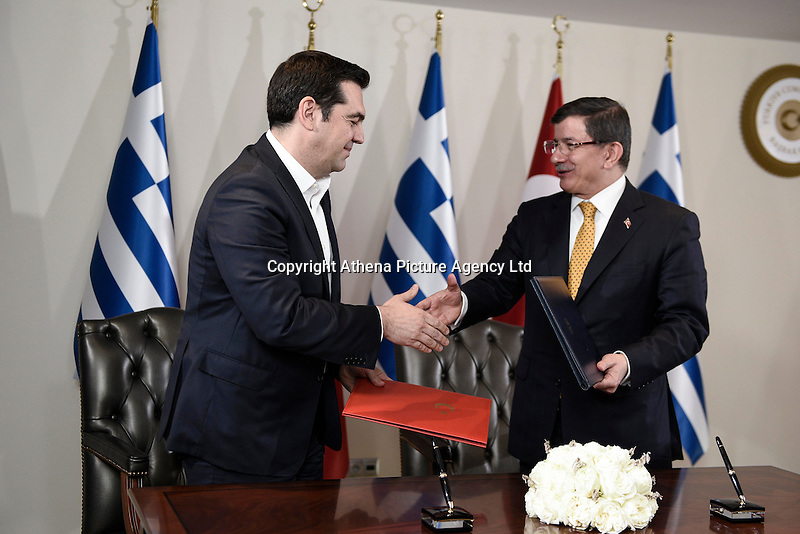 Pictured L-R: Alexis Tsipras and his Turkish counterpart Ahmet Davutoglou shake hands after signing their countrie's agreement Tuesday 08 March 2016<br /> Re: The Prime Ministers of Turkey Ahmet Davutoglu and Greece Alexis Tsipras have met in Smyrna, Turkey to discuss ways to enhance their cooperation as both countries are grappling with an influx of migrants,