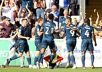 Bristol Rovers' Jonson Clarke-Harris (No.9) celebrates with team-mates after scoring the opening goal from the penalty spot<br /> <br /> Photographer Rich Linley/CameraSport<br /> <br /> The EFL Sky Bet League One - Lincoln City v Bristol Rovers - Saturday September 14th 2019 - Sincil Bank - Lincoln<br /> <br /> World Copyright © 2019 CameraSport. All rights reserved. 43 Linden Ave. Countesthorpe. Leicester. England. LE8 5PG - Tel: +44 (0) 116 277 4147 - admin@camerasport.com - www.camerasport.com