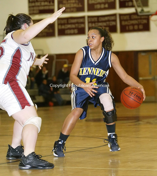 NAUGATUCK, CT 12/18/07- 121807BZ18-  Kennedy's Breana Morrison (11) looks for the pass under pressure from Naugatuck's Alyssa Echavarria  (35) during their game at Naugatuck High School Tuesday. <br /> Jamison C. Bazinet Republican-American