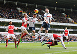 Tottenham's Toby Alderweireld and Eric Dier tussle with Arsenal's Per Mertesacker<br /> <br /> - English Premier League - Tottenham Hotspur vs Arsenal  - White Hart Lane - London - England - 5th March 2016 - Pic David Klein/Sportimage