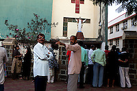 Families wait for children outside a christian school in Byculla, Mumbai, India. Photo by Suzanne Lee
