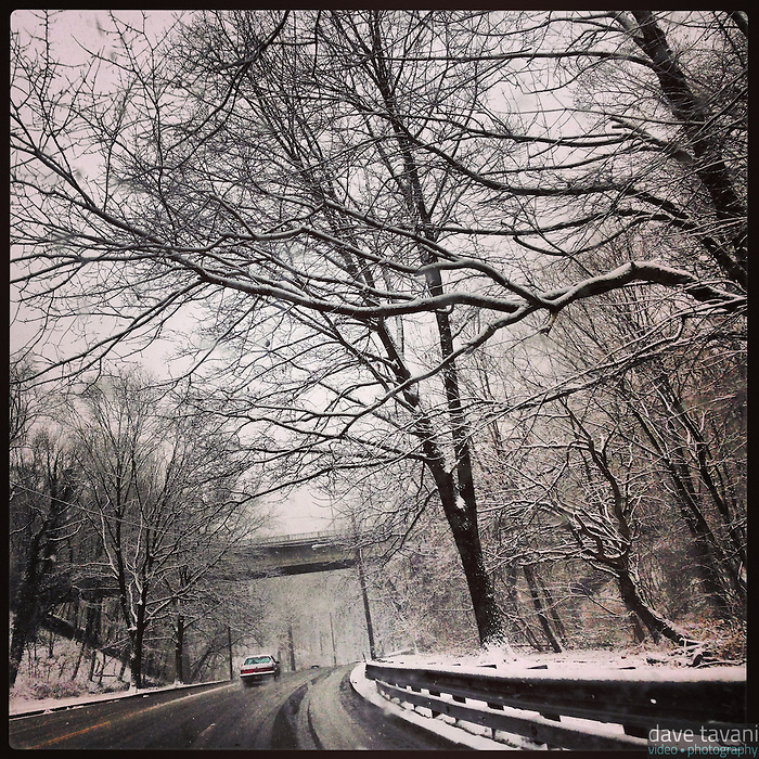 Snow falls on the inbound Lincoln Drive approaching Walnut Lane on December 29, 2012.