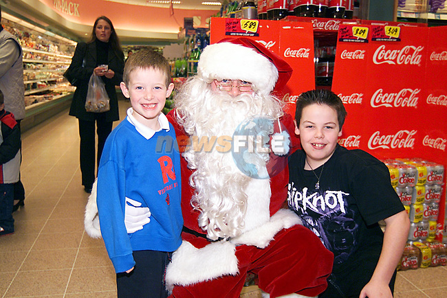 Blake and Dean Sweeney with Santa in Super Value Stockwell Street...Pic Tony Campbell Newsfile