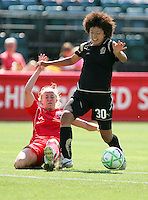 Eriko Arakawa avoids the slide tackle. FC Gold Pride defeated Washington Freedom 3-2 at Buck Shaw Stadium in Santa Clara, California on August 1, 2009.