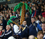 The tartan army depart with their rain soaked palm trees and walk through the streets of Cardiff after the match