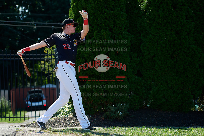 Batavia Muckdogs first baseman Sean Reynolds (25) hits sunflower seeds from manager Mike Jacobs (not pictured) before a game against the Auburn Doubledays on September 3, 2018 at Dwyer Stadium in Batavia, New York.  Auburn defeated Batavia 8-5.  (Mike Janes/Four Seam Images)