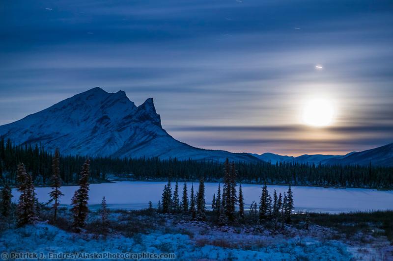 Winter landscape of Mount Sukakpak and the rising full moon, Brooks range, Arctic, Alaska