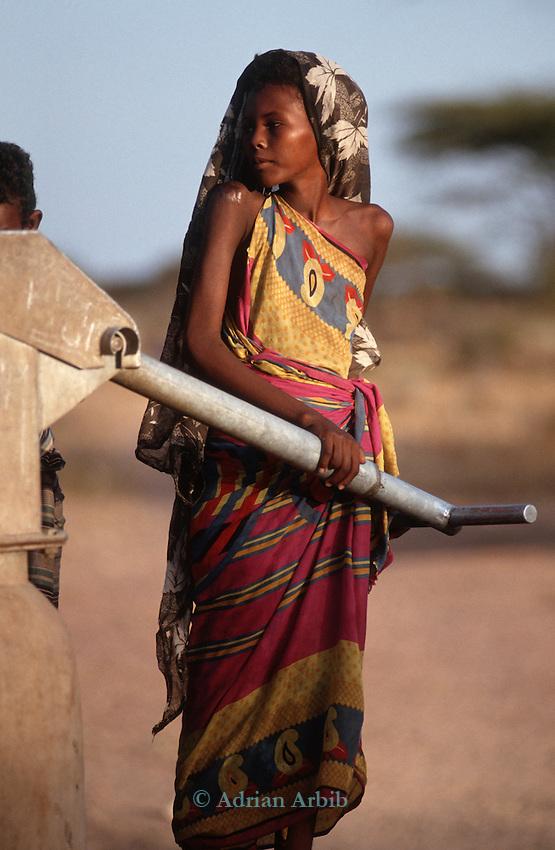 Somali girl filling water can from a borehole, Wajir, Somaliland, Kenya