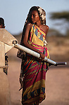 Somali girl filling water can from a borehole, Wajir, Somaliland, Kenya
