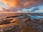 Kauai, H:I Evening clouds from Lumaha'i Beach with colors of the sky reflecting on the tide pools and rocks