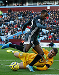 Tom Heaton of Aston Villa challenges Ricardo Pereira of Leicester City during the Premier League match at Villa Park, Birmingham. Picture date: 8th December 2019. Picture credit should read: Darren Staples/Sportimage