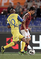 Calcio, Serie A: Roma vs Chievo Verona, Stadio Olimpico, Roma, 7 maggio  2013..AS Roma defender Dodo', of Brazil, right, is challenged by ChievoVerona midfielder Luciano, also of Brazil, during the Italian serie A football match between Roma and ChievoVerona at Rome's Olympic stadium, 7 maggio  2013..UPDATE IMAGES PRESS/Isabella Bonotto