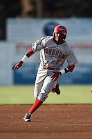 Auburn Doubledays shortstop Osvaldo Abreu (7) runs the bases after hitting a triple during a game against the Batavia Muckdogs on June 14, 2014 at Dwyer Stadium in Batavia, New York.  Batavia defeated Auburn 7-2.  (Mike Janes/Four Seam Images)